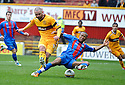 CALEY'S KENNY GILLET MAKES A CHALLENGE ON MOTHERWELL'S MICHAEL HIGDON AS HE SHOOTS AT GOAL..14/01/2012 sct_jsp003_motherwell_v_ict     .Copyright  Pic : James Stewart.James Stewart Photography 19 Carronlea Drive, Falkirk. FK2 8DN      Vat Reg No. 607 6932 25.Telephone      : +44 (0)1324 570291 .Mobile              : +44 (0)7721 416997.E-mail  :  jim@jspa.co.uk.If you require further information then contact Jim Stewart on any of the numbers above.........