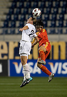 Abby Wambach (20) of the USWNT goes up for a header against Xu Wenjia (4) of China during an international friendly at PPL Park in Chester, PA.  The U.S. tied China, 1-1.