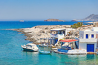 "Traditional fishermen houses with the impressive boat shelters, also known as ""syrmata"" in Mytakas of Milos, Greece"