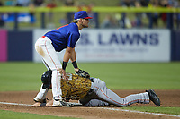 Dustin Harris (20) of the Down East Wood Ducks slides into third base under the tag by AJ Gill (21) of the Kannapolis Cannon Ballers at Atrium Health Ballpark on May 8, 2021 in Kannapolis, North Carolina. (Brian Westerholt/Four Seam Images)