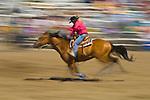 A woman barrel racing at the Jordan Valley Big Loop Rodeo