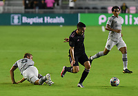 12th May 2021; Fort Lauderdale, Miami, USA;  Midfielder Djordje Mihailovicof CF Montreal goes down as Midfielder Lewish Morgan (7) of Inter Miami CF breaks with the ball the Inter Miami CF match against CF Montreal on May 12, 2021 at DRV PNK Stadium.
