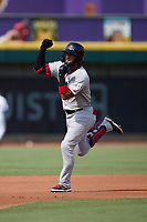 Miguel Aparicio (8) of the Hickory Crawdads celebrates as he rounds the bases after hitting a home run on the first pitch of the game against the Winston-Salem Dash at Truist Stadium on July 10, 2021 in Winston-Salem, North Carolina. (Brian Westerholt/Four Seam Images)