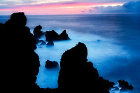 Sunrise and volcanic rocks near black sand beach. Waiananappa Trail. Maui, Hawaii