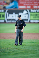 Umpire Bobby Tassone handles the calls on the bases during a game between the Ogden Raptors and the Idaho Falls Chukars at Lindquist Field on August 29, 2018 in Ogden, Utah. Idaho Falls defeated Ogden 15-6. (Stephen Smith/Four Seam Images)