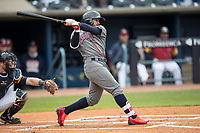 Lehigh Valley IronPigs second baseman Jesmuel Valentin (7) follows through on his swing against the Toledo Mud Hens during the International League baseball game on April 30, 2017 at Fifth Third Field in Toledo, Ohio. Toledo defeated Lehigh Valley 6-4. (Andrew Woolley/Four Seam Images)