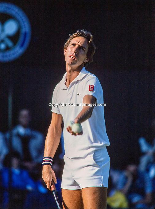 June 30, 1982, London, England, AELTC, All England Club, Wimbledon, Dick Stockton(USA) serves<br /> Photo: Tennisimages/Henk Koster