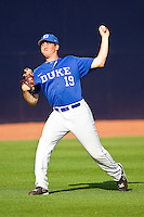 Dillon Haviland #19 of the Duke Blue Devils warms up in the outfield prior to the game against the Virginia Cavaliers at Durham Bulls Athletic Park on April 20, 2012 in Durham, North Carolina.  The Blue Devils defeated the Cavaliers 6-3.  (Brian Westerholt/Four Seam Images)