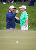 Golfer Stephen Gallagher celebrates with Brian McFadden (Singer / Songwriter) after holing from the bunker during the BMW PGA PRO-AM GOLF at Wentworth Drive, Virginia Water, England on 23 May 2018. Photo by Andy Rowland.