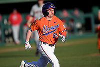 Second baseman Mac Starbuck (24) of the Clemson Tigers runs out a batted ball against the Stony Brook Seawolves on Friday, February 21, 2020, at Doug Kingsmore Stadium in Clemson, South Carolina. Clemson won, 2-0. (Tom Priddy/Four Seam Images)