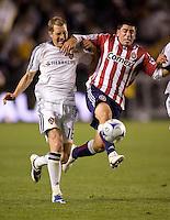 LA Galaxy's Gregg Berhalter and Chivas USA's Alecko Eskandarian battle. Chivas USA and the LA Galaxy played to a 0-0 draw at Home Depot Center stadium in Carson, California on Saturday April 11, 2009.  .