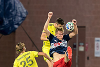 FOXBOROUGH, MA - OCTOBER 3: Dave Romney #4 of Nashville SC and Adam Buksa #9 of New England Revolution battle for head ball during a game between Nashville SC and New England Revolution at Gillette Stadium on October 3, 2020 in Foxborough, Massachusetts.