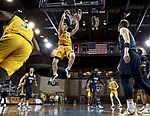SIOUX FALLS, SD - MARCH 9: Rocky Kreuser #34 of the North Dakota State Bison slams home two points against the Oral Roberts Golden Eagles during the 2021 Men's Summit League Basketball Championship at the Sanford Pentagon in Sioux Falls, SD. (Photo by Dave Eggen/Inertia)