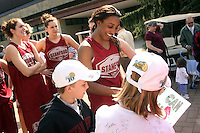 3 April 2008: The team departs for the Final Four and is sent off by fans and staff of the Athletic Department near Maples Pavilion in Stanford, CA. Pictured is Candice Wiggins signing autographs and Morgan Clyburn and Ashley Cimino in the background.