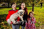 Ally Spring, Sarah Donnellan and Myia Spring from Tralee taking Charlie the dog for a walk around the town park on Tuesday.