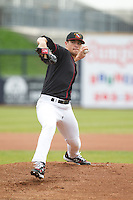 Quad Cities River Bandits pitcher Brian Holmes #41 pitches during a game against the Great Lakes Loons at Modern Woodmen Park on April 29, 2013 in Davenport, Iowa. (Brace Hemmelgarn/Four Seam Images)
