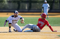 Ryan Nelson (8) of the Quinnipiac Bobcats fields a throw as Richard De la Cruz (12) of the Radford Highlanders steals second base at David F. Couch Ballpark on March 4, 2017 in Winston-Salem, North Carolina.  The Highlanders defeated the Bobcats 4-0.  (Brian Westerholt/Four Seam Images)