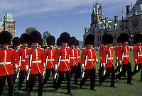 AJ2929, Ottawa, guards, Parliament, Ontario, Canada, Changing of the Guards takes place on the lawn of the Parliament Buildings on Parliament Hill in Ottawa the capital city of Canada in the Province of Ontario. Guards are wearing red jackets, black fuzzy hats, and black pants.