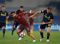 Calcio, Serie A: Roma vs Inter. Roma, stadio Olimpico, 2 ottobre 2016.<br /> Roma's Mohamed Salah, left, is chased by FC Inter's Davide Santon during the Italian Serie A football match between Roma and FC Inter at Rome's Olympic stadium, 2 October 2016.<br /> UPDATE IMAGES PRESS/Isabella Bonotto