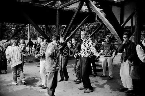 """Moscow, Russia<br /> Soviet Union<br /> August 1991<br /> <br /> Gorky Park - young teenagers dance at a small pavilion at dusk as there are no discos or night-clubs in Moscow at this time.<br /> <br /> In December 1991, food shortages in central Russia had prompted food rationing in the Moscow area for the first time since World War II. Amid steady collapse, Soviet President Gorbachev and his government continued to oppose rapid market reforms like Yavlinsky's """"500 Days"""" program. To break Gorbachev's opposition, Yeltsin decided to disband the USSR in accordance with the Treaty of the Union of 1922 and thereby remove Gorbachev and the Soviet government from power. The step was also enthusiastically supported by the governments of Ukraine and Belarus, which were parties of the Treaty of 1922 along with Russia.<br /> <br /> On December 21, 1991, representatives of all member republics except Georgia signed the Alma-Ata Protocol, in which they confirmed the dissolution of the Union. That same day, all former-Soviet republics agreed to join the CIS, with the exception of the three Baltic States."""