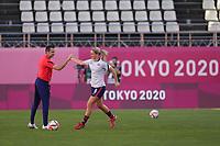 KASHIMA, JAPAN - AUGUST 4: Head Coach Vlatko Andonovski of the United States greets Lindsey Horan #9 of the United States before a game between Australia and USWNT at Kashima Soccer Stadium on August 4, 2021 in Kashima, Japan.