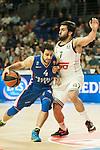 Real Madrid´s Facundo Campazzo and Anadolu Efes´s Dogus Balbay during 2014-15 Euroleague Basketball match between Real Madrid and Anadolu Efes at Palacio de los Deportes stadium in Madrid, Spain. December 18, 2014. (ALTERPHOTOS/Luis Fernandez)