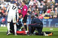 Tammy Abraham of Swansea receives treatment for an injury during the Fly Emirates FA Cup Quarter Final match between Swansea City and Tottenham Hotspur at the Liberty Stadium, Swansea, Wales, UK. Saturday 17 March 2018