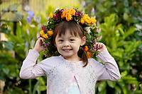 BNPS.co.uk (01202 558833)<br /> Pic: ZacharyCulpin/BNPS<br /> <br /> Pictured: Blythe Woollacott, 3, wears one of the spectacular flower crowns created as part of Garden Day in Southwark<br /> <br /> Londoners celebrate Garden Day by making flower crowns in the gardens of St George the Martyr chruch in Southwark.  <br /> <br /> Garden Day is back for a third successive year on Sunday, 9th May 2021 to celebrate outdoor and indoor garden spaces. The nationwide movement is called on plant-lovers to make a flower crown, and share their plant spaces with family and<br /> friends