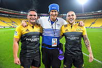 """Photographer Russell """"Chainsaw"""" Potts with Norths players Leni Apisai (left) and TJ Perenara after the Super Rugby match between the Hurricanes and Stormers at Westpac Stadium in Wellington, New Zealand on Friday, 5 May 2017. Photo: Dave Lintott / lintottphoto.co.nz"""