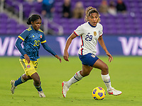 ORLANDO, FL - JANUARY 18: Linda Caicedo #20 defends Catarina Macario #29 of the USWNT during a game between Colombia and USWNT at Exploria Stadium on January 18, 2021 in Orlando, Florida.
