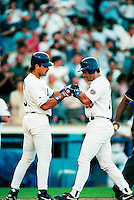 Mike Piazza and Eric Karros of the Los Angeles Dodgers during a game at Dodger Stadium in Los Angeles, California during the 1997 season.(Larry Goren/Four Seam Images)