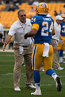 Pitt head coach Pat Narduzzi greets running back James Conner. The Pitt Panthers defeated the Georgia Tech Yellow Jackets 37-34 at Heinz Field in Pittsburgh, Pennsylvania on October 08, 2016.