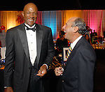 Former Rocket Clyde Drexler with judge Eric Andell at the Houston Rockets Tux & Tennies benefit at Toyota Center Thursday March  27,2008. (Dave Rossman/For the Chronicle)