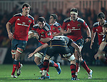 Blind-side flanker Paddy Butler of Munster Rugby is tackled by Second row Cory Hill of Newport Gwent Dragons.<br /> <br /> Guiness Pro 12<br /> Newport Gwent Dragons v Munster Rugby<br /> Rodney Parade<br /> 21.11.14<br /> ©Steve Pope-SPORTINGWALES