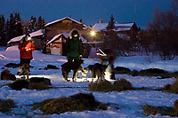 Chief vet Stu Nelson talks with Jessie Royer on Sunday morning in Kaltag during Iditarod 2008