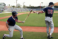 Boston Red Sox third baseman Wade Boggs (26) jokes with Butch Hobson (55) during spring training circa 1991 at Chain of Lakes Park in Winter Haven, Florida.  (MJA/Four Seam Images)