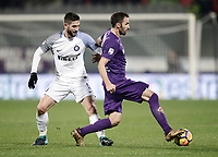 Calcio, Serie A: Fiorentina - Inter, stadio Artemio Franchi Firenze 5 gennaio 2018.<br /> Fiorentina's Milan Badelj (r) in action with Inter's Roberto Gagliardini (l) during the Italian Serie A football match between Fiorentina and Inter Milan at Florence's Artemio Franchi stadium, January 5 2018.<br /> UPDATE IMAGES PRESS/Isabella Bonotto