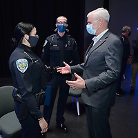 Rep. Steve Womack (right) speaks Thursday, April 1, 2021, with Natalie Eucce (left) and Seay Floyd, both officers with the Fayetteville Police Department, before awarding them with the Attorney General's Award for Distinguished Service in Policing for their actions after the killing of fellow officer Stephen Carr Dec. 7, 2019. Womack made the presentation during a ceremony at the Fayetteville Public Library before touring the library's newly opened addition. Visit nwaonline.com/210402Daily/ for today's photo gallery. <br /> (NWA Democrat-Gazette/Andy Shupe)