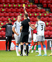 10th October 2020; Bescot Stadium, Walsall, West Midlands, England; English Football League Two, Walsall FC versus Colchester United; Luke Norris of Colchester United is shown a yellow card from Referee Declan Bourne