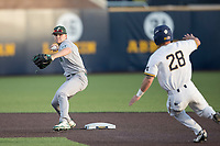 Eastern Michigan Eagles second baseman Drake Peggs (5) turns a double play during the NCAA baseball game as Michigan Wolverines baserunner Nick Poirier (28) slides into second on May 16, 2017 at Ray Fisher Stadium in Ann Arbor, Michigan. Michigan defeated Eastern Michigan 12-4. (Andrew Woolley/Four Seam Images)