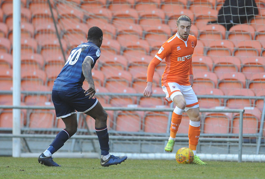 Blackpool's Antony Evans under pressure from Walsall's Isaiah Osbourne<br /> <br /> Photographer Kevin Barnes/CameraSport<br /> <br /> The EFL Sky Bet League One - Blackpool v Walsall - Saturday 9th February 2019 - Bloomfield Road - Blackpool<br /> <br /> World Copyright © 2019 CameraSport. All rights reserved. 43 Linden Ave. Countesthorpe. Leicester. England. LE8 5PG - Tel: +44 (0) 116 277 4147 - admin@camerasport.com - www.camerasport.com