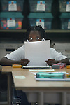 A student appears to be slightly confused on what she is reading at a elementary schools in San Francisco, California.