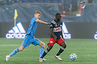 FOXBOROUGH, MA - SEPTEMBER 02: Kekuta Manneh #31 of New England Revolution dribbles at midfield as Keaton Parks #55 of New York City FC defends during a game between New York City FC and New England Revolution at Gillette Stadium on September 02, 2020 in Foxborough, Massachusetts.