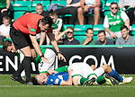 Hibs v St Johnstone….24.08.19      Easter Road     SPFL <br />Hibs captain David Gray lies injured on Scott Tanser after bringing him down<br />Picture by Graeme Hart. <br />Copyright Perthshire Picture Agency<br />Tel: 01738 623350  Mobile: 07990 594431