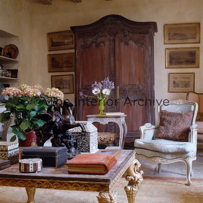 A large armoire dominates one wall of the living room