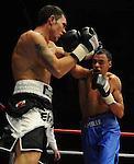 Jeff Evans (Black Shorts) V Jamie Ambler (Blue Shorts). Joe Calzaghe Promotions Boxing Evening .Date: Friday 20/11/2009,  .© Ian Cook IJC Photography, 07599826381, iancook@ijcphotography.co.uk,  www.ijcphotography.co.uk, .