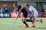 Steve Edwards shadowed by Jacob Smith. Men's North v South hockey match, St Pauls Collegiate, Hamilton, New Zealand. Saturday 17 April 2021 Photo: Simon Watts/www.bwmedia.co.nz
