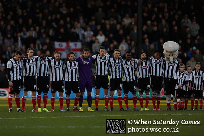 Grimsby Town 1 Lincoln City 3, 28/12/2014. Blundell Park, Football Conference. Grimsby players and mascot observe a one minute silence  for former Town chairman Peter Furneaux.  Photo by Paul Thompson.
