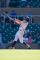 Surprise Saguaros left fielder Bryan Reynolds (10), of the Pittsburgh Pirates organization, follows through on his swing during an Arizona Fall League game against the Salt River Rafters at Salt River Fields at Talking Stick on November 5, 2018 in Scottsdale, Arizona. Salt River defeated Surprise 4-3 . (Zachary Lucy/Four Seam Images)