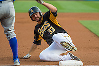 Roger Kieschnick (33) of the Salt Lake Bees slides into third base against the Iowa Cubs in Pacific Coast League action at Smith's Ballpark on August 21, 2015 in Salt Lake City, Utah. The Bees defeated the Cubs 12-8.  (Stephen Smith/Four Seam Images)
